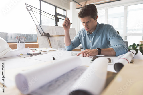 Professional architect is working in office