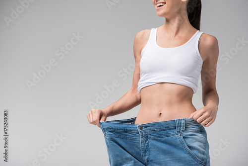 Fotografie, Obraz  Joyful slim girl showing result of diet