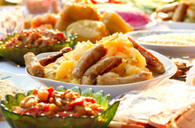 Sausages With Potatoes And Salad