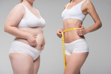 Women Measuring Their Stomachs