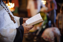 Priest Holding A Bible. Orthod...