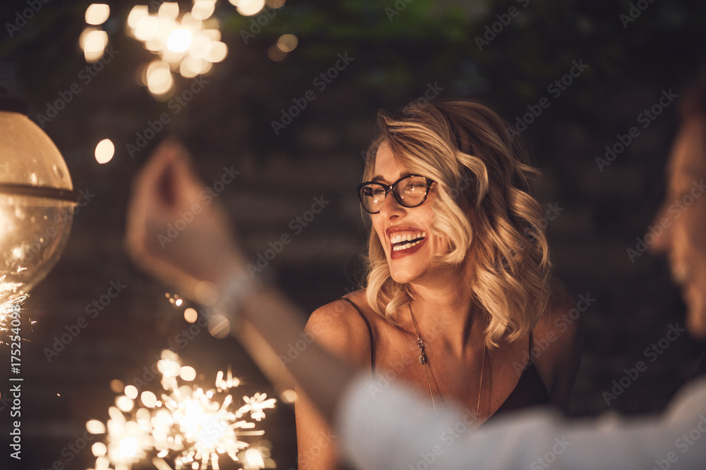 Fototapeta Blond woman laughing at party
