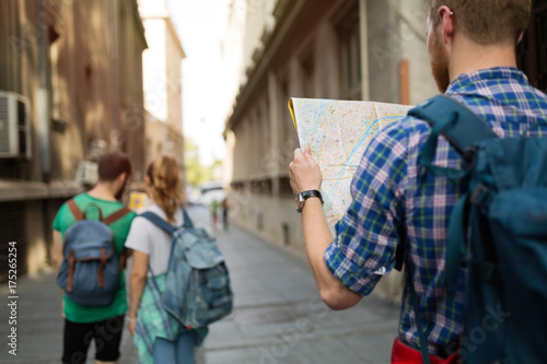 Fotografie, Tablou  Tourist holding map and sightseeing in city