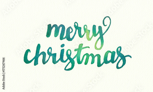 Fototapeta Merry Christmas greeting in hand painted watercolor design, flowing fancy letter