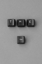 'The End' Written With Computer Keyboard Keys On A Paper Background