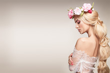 Beautiful Woman Portrait With Long Blonde Hair And Flowers On Head. Tender Bride.