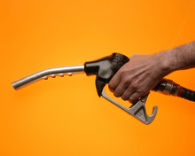 Hand Holding Petrol Pump On Ye...