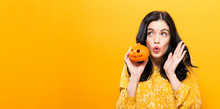 Young Woman Holding A Pumpkin ...