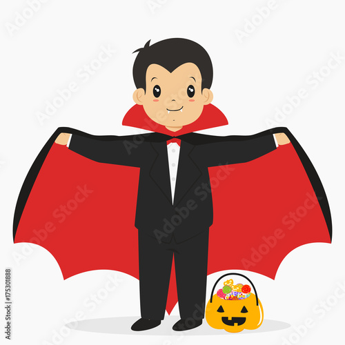 Fotografie, Obraz  a boy wearing dracula costume for Halloween party and pumpkin bucket full of candies