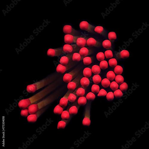 Fotografie, Obraz  Red match heads on a black background