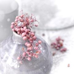 snow on blush pink berries in grey vase