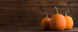 canvas print picture Pumpkins on wooden background