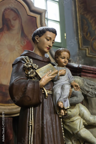 Saint Anthony of Padua holding baby Jesus statue with lily flower, church in Wro Wallpaper Mural