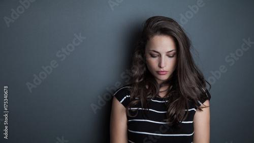 Cuadros en Lienzo young beautiful pensive woman portrait studio