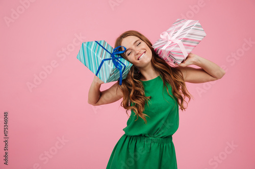 Portrait of a happy woman in dress holding present boxes Wallpaper Mural