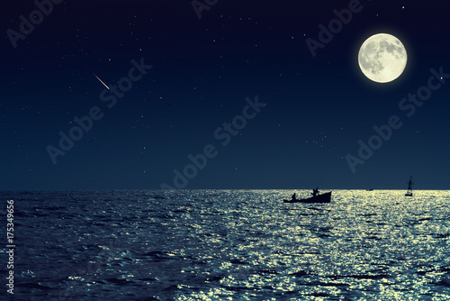 Foto op Canvas Nacht Scenic view of small fishing boat in calm sea water at night and full moon