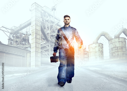 Portrait of a worker on factory background