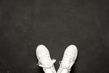 Stylish flat lay Of White Sneakers On black Background