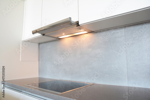 Fotografía  Close up on modern air exhauster kitchen fan or Range Hood