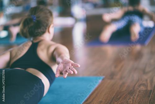 Staande foto School de yoga Group of girls to exercise, yoga in the studio