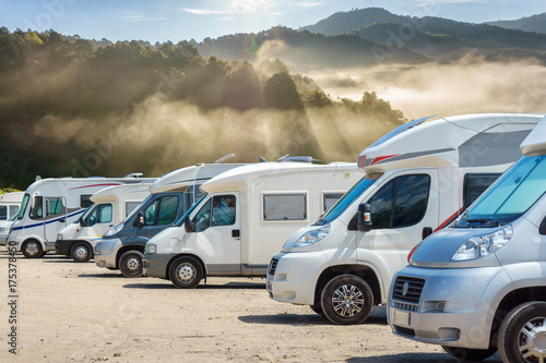 Poster Lieu connus d Asie Close up motorhomes parked in a row with fog in the morning background, Chiang Mai Province, Thailand