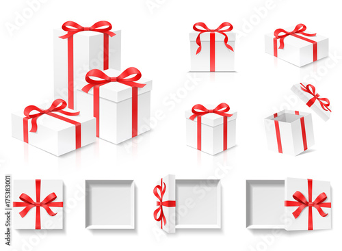 Photo  Empty open gift box set with red color bow knot and ribbon isolated on white background