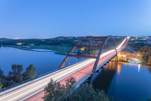 Top View Of Pennybacker Bridge Or 360 Bridge, A Landmark In Austin, Texas, USA At Blue Hour. Colorful Car Light Trail In Traffic. Top Of Town Lake And Hill Country Landscape.