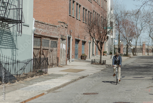 African american business man riding his bike in Brooklyn, NY