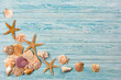 Summer sea background - shells, star on a wooden blue background