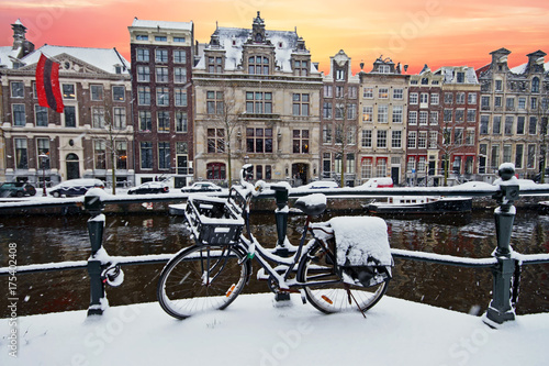 Amsterdam in winter in the Netherlands at sunset #175402408