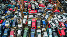 A Junkyard Of Wrecked Cars Seen From Above