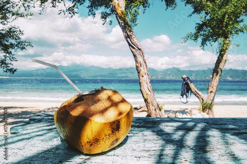 Fresh coconut drink by the beach