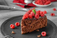 Piece Of Chocolate Cake With Raspberries On Plate
