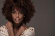 Leinwandbild Motiv Beautiful woman with afro hairstyle posing.