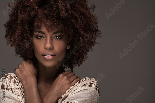 Beautiful woman with afro hairstyle posing. Canvas Print