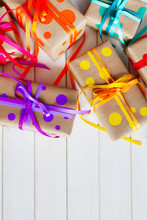 Colored Gift Boxes, Tied With Ribbons. Multicolored Gifts.