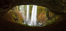 View Of A Waterfall From Behind Through An Eye Shaped Cave