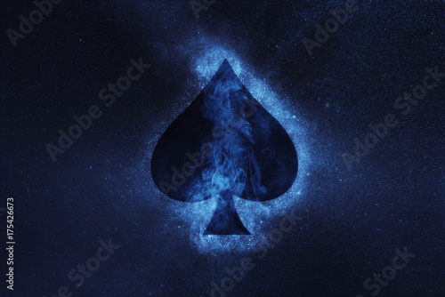 Photo  Playing card. Spade symbol. Abstract night sky background