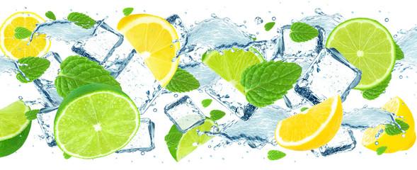 Fototapeta lime and lemon splash water and ice cubes isolated