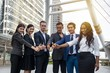 Smile businessmen showing thumb with confidence