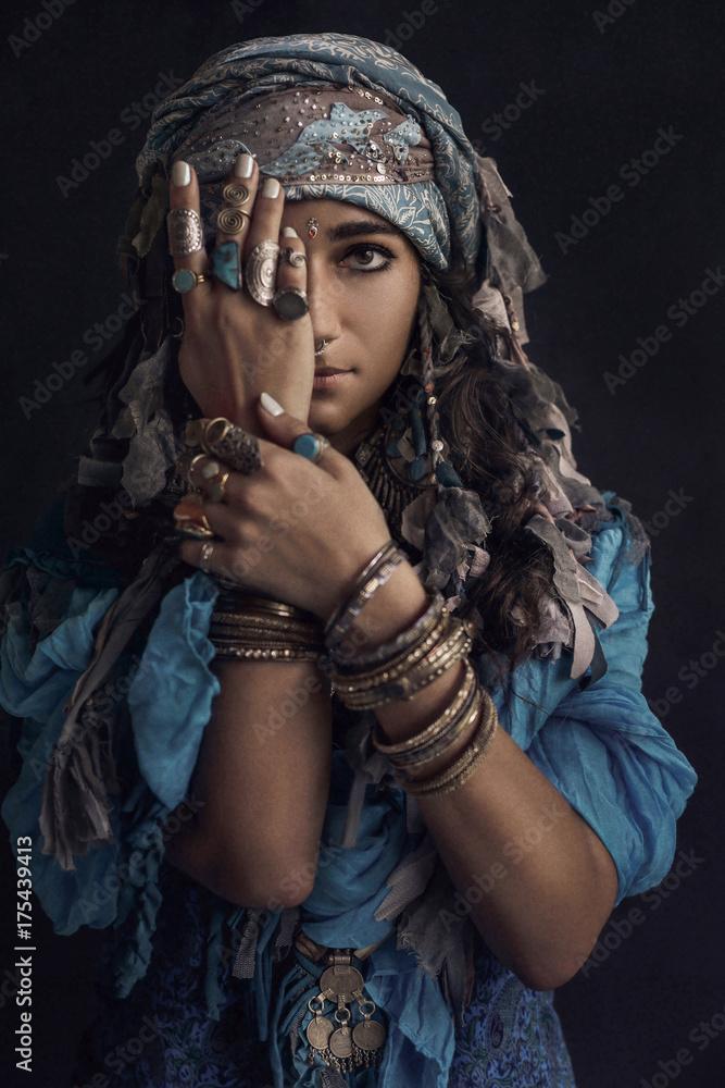 Fototapeta gypsy style young woman wearing tribal jewellery portrait