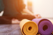 Closeup view of yoga mat and woman on background