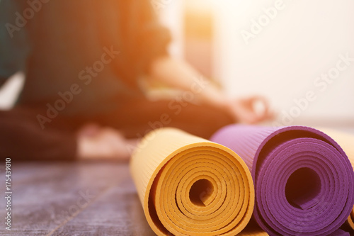 Spoed Foto op Canvas School de yoga Closeup view of yoga mat and woman on background
