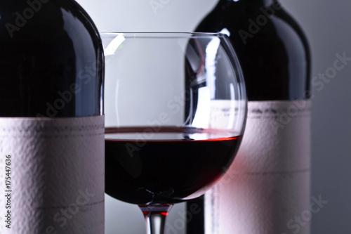 Foto op Plexiglas Bar Bottles and glass of red wine .