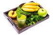 Fresh organic green cocktail made from fruits and vegetables as a healthy drink on wooden tray