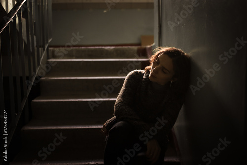 Obraz woman in  sweater at the steps, dark style - fototapety do salonu