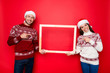 Discount, marketing, sales, advertisement, presents, gifts selling concept. Holly jolly x mas, time! Cheerful married lovers present a border, beaming smiles, noel costumes, head wear