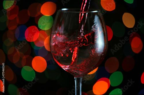 Beautiful splash of red wine in a glass