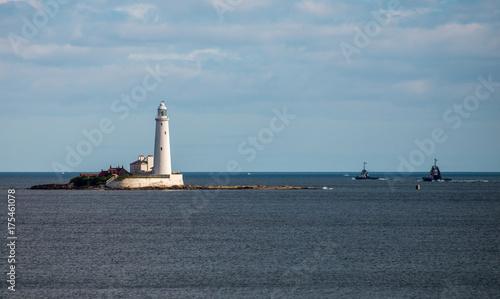 Foto op Aluminium Vuurtoren A lighthouse on an island in Whitley Bay near Newcastle upon Tyne, England
