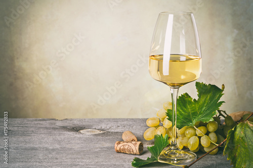 Fototapeta Glass of white wine on vintage wooden table obraz